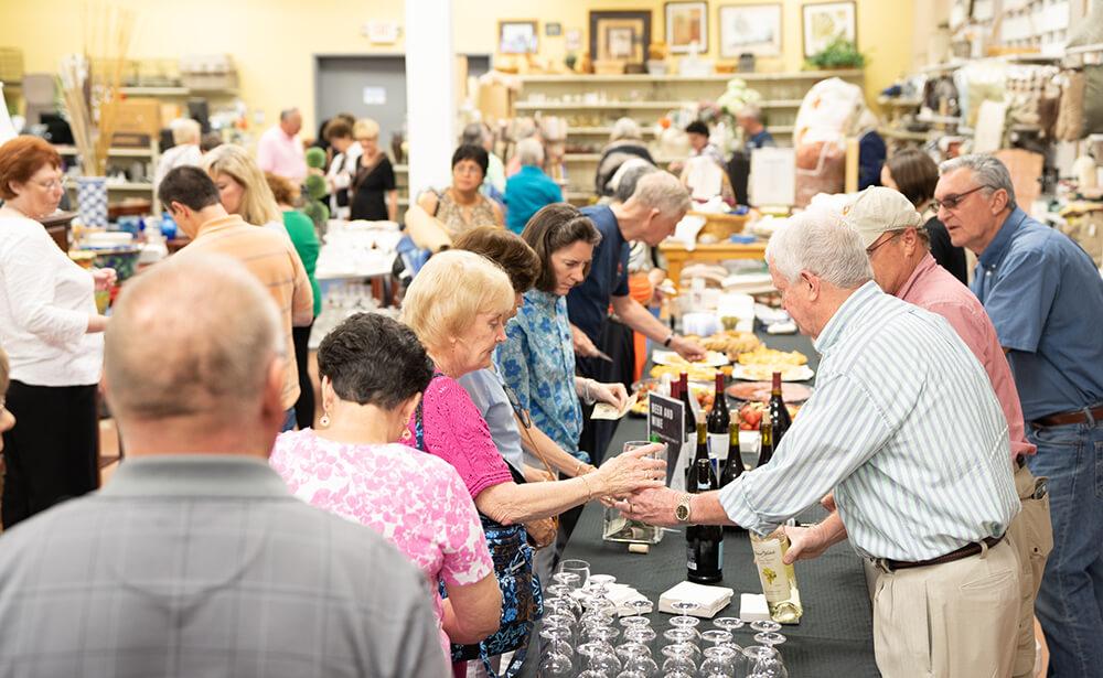 people sampling wine and food