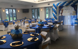blue and gold decorations with balloons